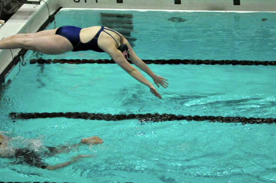 Staples senior captain Molly Loftus was an All-Stater all four years and will swim for a Division I college next year. Photo: Contributed Photo / Ron Wimer