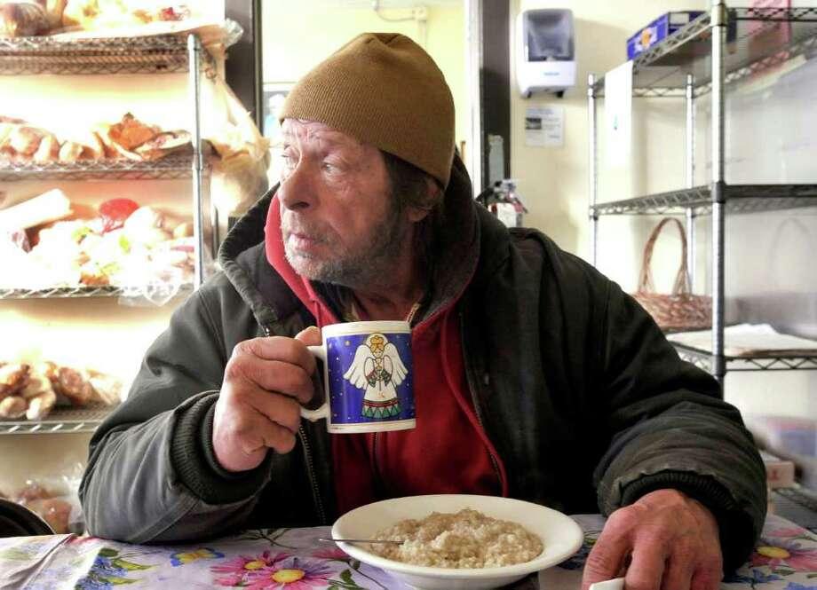 Lloyd Coffey has breakfast at Dorothy Day Hospitality House's Morning Glory program in Danbury Tuesday, Feb. 22, 2011 Photo: Michael Duffy / The News-Times