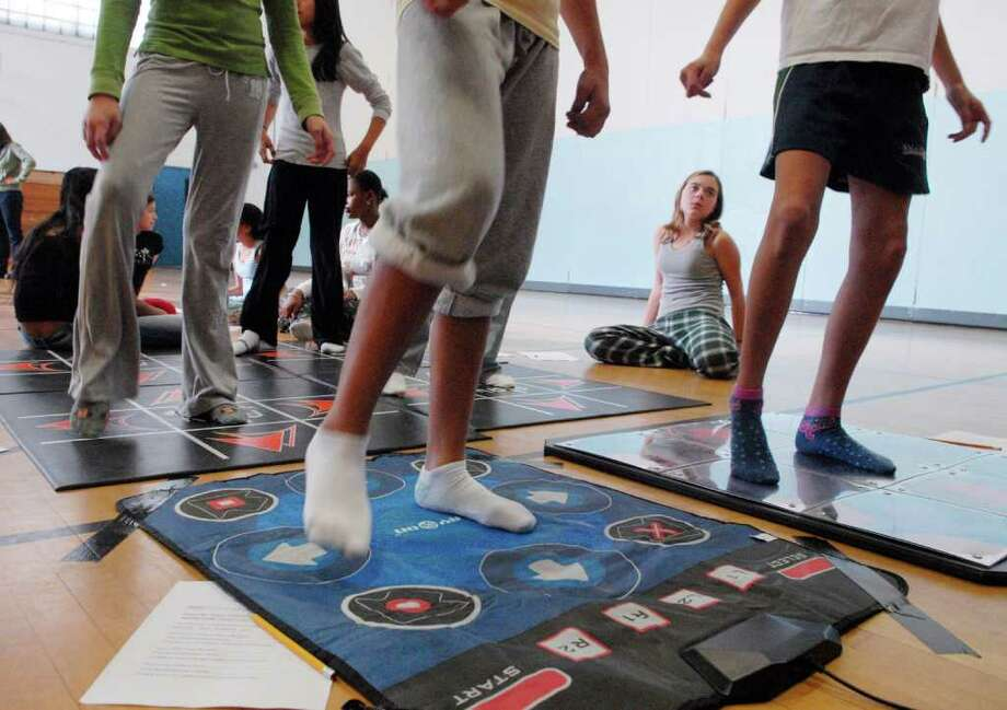 'Dance Dance Revolution,' and a host of other interactive games will be featured during a special kids night at Stamford's Jewish Community Center, March 5. The evening also will feature an arts program for younger children. Photo: File Photo / Stamford Advocate File Photo