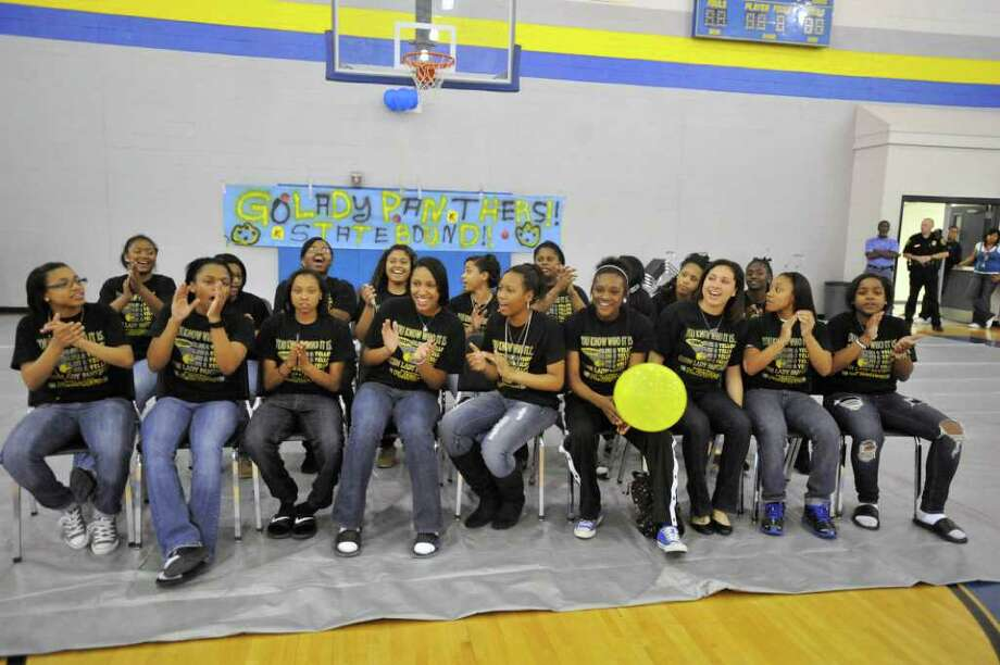 The Ozen Lady Panthers basketball team celebrates during a pep rally at Ozen High School gymnasium before their departure for the state tournament in Austin. The Ozen girls will face Canyon in a semifinal matchup on Thursday for a shot at the Class 4A state title.  Wednesday, February 2, 2011.  Valentino Mauricio/The Enterprise Photo: Valentino Mauricio / Beaumont