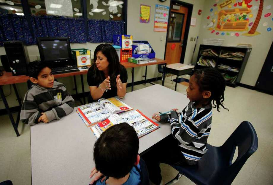 Student teacher Kristen Powell, a 24-year-old senior at Texas A&M-San Antonio, currently instructs students at Southwest Elementary School from 7:30 a.m. to 3:30 p.m. every day, ruling out the possibility of a job. She said she's not sure how she would have made it through college without a TEXAS grant. Photo: Kin Man Hui/Express-News / kmhui@express-news.net