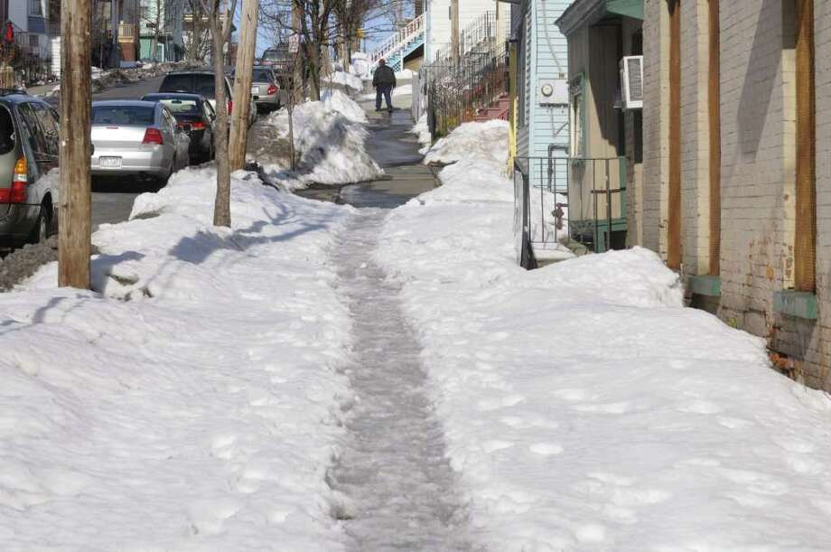 A view along Lark St. shows a section of sidewalk that has not been cleared of the snow covering on Tuesday, Mar. 1, 2011.  (Paul Buckowski / Times Union) Photo: Paul Buckowski
