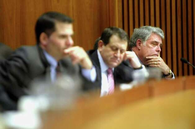 Assemblymen, Marcus Molinaro, left, Joseph Morelle, center, and Jack McEneny, right, listen to testimony from members of New York State Association of Towns during an Assembly budget hearing at the legislative office building in Albany, NY on Tuesday, Mar. 2, 2011.  The hearing was on the property tax cap which has been proposed by Governor Andrew Cuomo. (Paul Buckowski / Times Union) Photo: Paul Buckowski