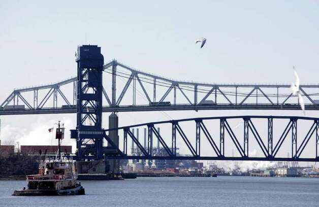 The Goethals Bridge, top, is seen from Elizabeth, N.J., Tuesday, March 1, 2011.  (AP Photo/Seth Wenig) Photo: Seth Wenig