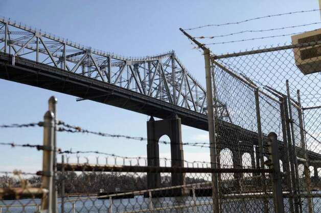 The Goethals Bridge is seen over a fence in Elizabeth, N.J., Tuesday, March 1, 2011.  (AP Photo/Seth Wenig) Photo: Seth Wenig
