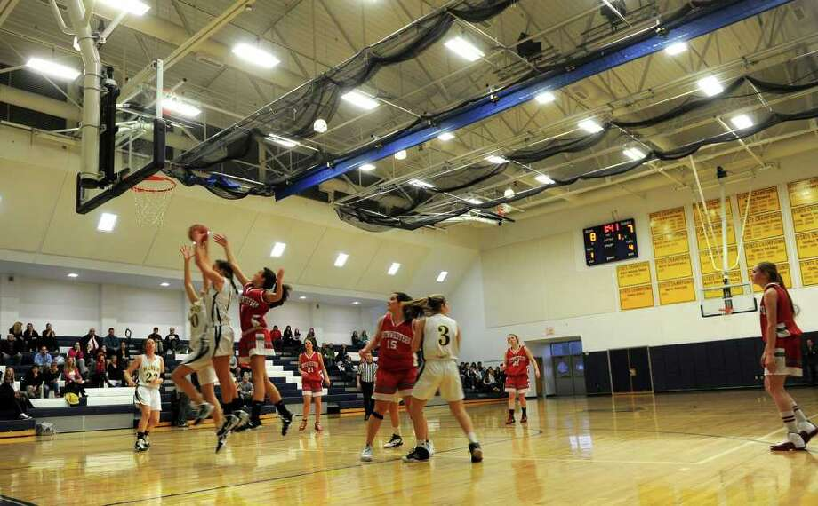 Highlights from FCIAC Class M girls basketball playoff tournament action between Weston and Northwestern in Weston, Conn. on Tuesday March 1, 2011. Photo: Christian Abraham / Connecticut Post