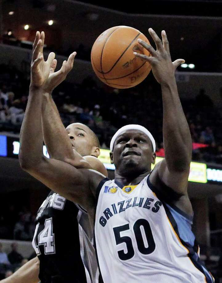 Memphis Grizzlies forward Zach Randolph (50) fights for a rebound against San Antonio Spurs guard Gary Neal (14) during the second half of an NBA basketball game in Memphis, Tenn., Tuesday, March 1, 2011. Memphis won 109-93. Photo: AP