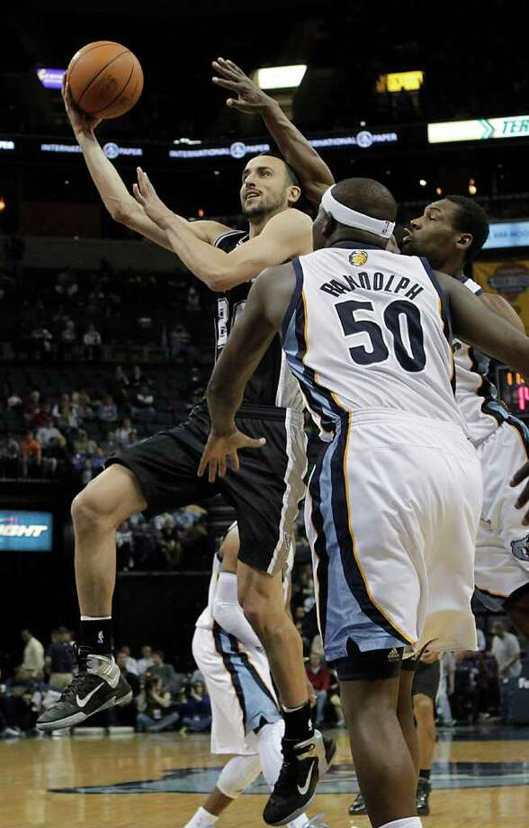 San Antonio Spurs guard Manu Ginobili, left, of Argentina, drives to the basket against Memphis Grizzlies' Tony Allen, right, and Zach Randolph (50) during the first half of an NBA basketball game in Memphis, Tenn., Tuesday, March 1, 2011. Photo: AP