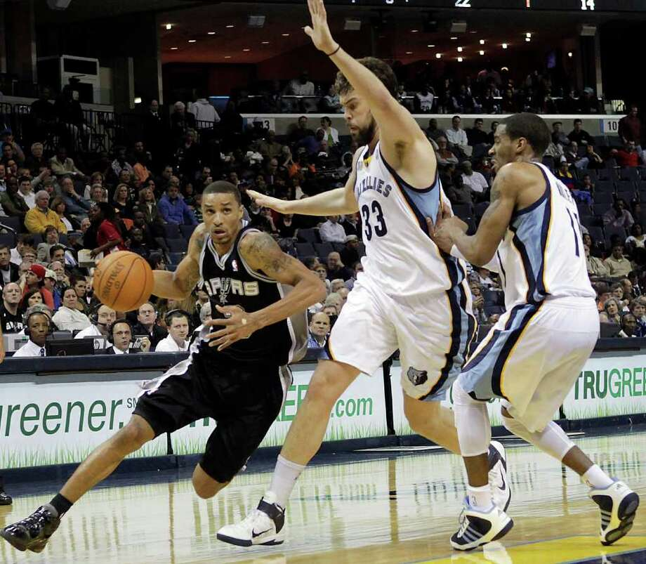 San Antonio Spurs guard George Hill goes to the basket against Memphis Grizzlies center Marc Gasol (33), of Spain, and guard Mike Conley (11) during the first half of an NBA basketball game in Memphis, Tenn., Tuesday, March 1, 2011. Photo: AP