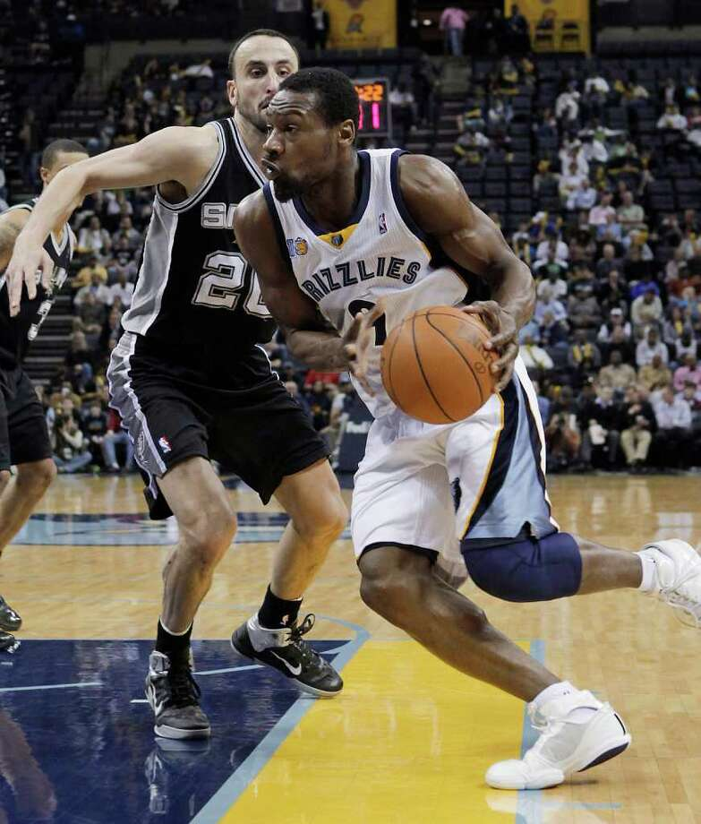 Memphis Grizzlies guard Tony Allen (9) drives to the basket against San Antonio Spurs guard Manu Ginobili, of Argentina, during the second half of an NBA basketball game in Memphis, Tenn., Tuesday, March 1, 2011. Memphis won 109-93. Photo: AP