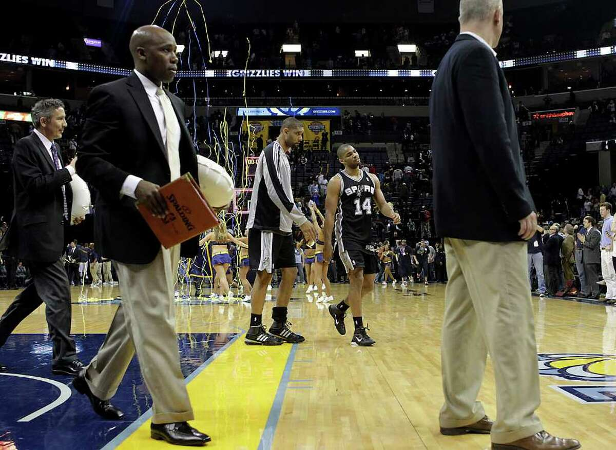 San Antonio Spurs' Gary Neal (14) and Tim Duncan leave the court after the Spurs' 109-93 loss to the Memphis Grizzlies in an NBA basketball game in Memphis, Tenn., Tuesday, March 1, 2011.