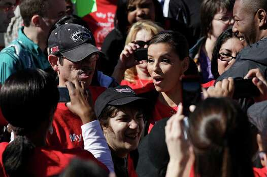 "METRO-- Actress Eva Longoria, center right, mingles with the crowd during ""Rally for the Future,"" at Morgan's Wonderland, Tuesday, March 1, 2011. Gordon Hartman and San Antonio Councilman John Clamp were also on hand to kickoff Disabilities Awareness Month. Some of the supporters, including Longoria and Hartman, were headed to Austin after the rally. They were scheduled for another rally on the North Steps of the State Capitol in order to try and avoid budget cuts to programs benefiting the disable.   JERRY LARA/glara@express-news.net Photo: JERRY LARA, SAN ANTONIO EXPRESS-NEWS / glara@express-news.net"