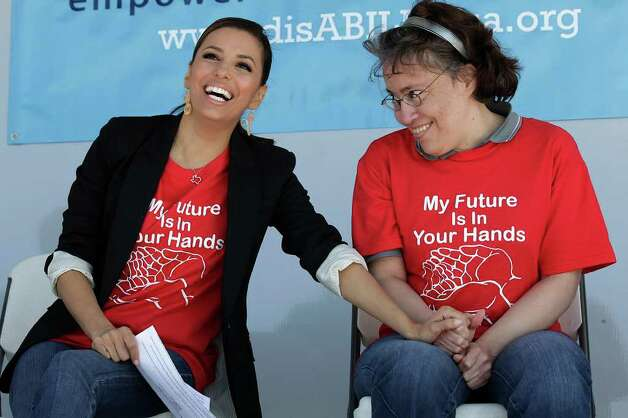 Actress Eva Longoria shares a moment with her sister, Liza, the inspiration for Longoria's nonprofit organization Eva's Heroes. The annual poker fundraiser for Eva's Heroes will be Saturday at the JW Marriott San Antonio Hill Country Resort & Spa Photo: File Photo, San Antonio Express-News / glara@express-news.net