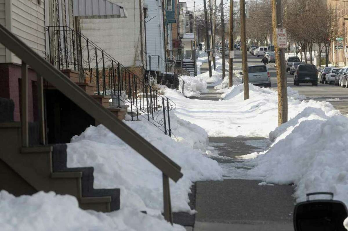A view along Orange St. shows a section of sidewalk that has not been cleared of the snow covering on Tuesday, Mar. 1, 2011. (Paul Buckowski / Times Union)