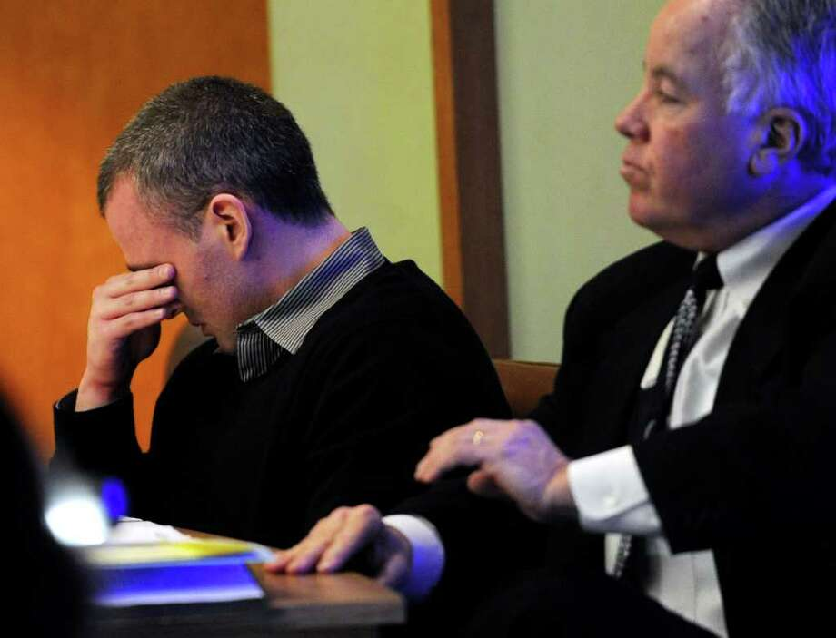 Christopher DiMeo gets emotional as he listens to testimony during the penalty phase of his trial in Superior Court in Bridgeport, Conn. on Wednesday, March 2, 2011. DiMeo has been found guilty of two counts of murder and one count each of first-degree robbery and capital felony in the deaths of Tim and Kim Donnelly during the robbery of their Fairfield jewelry store in February of 2005. Photo: Brian A. Pounds / Connecticut Post