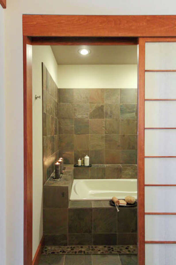 Bathroom fixtures and sinks were done by Central Plumbing and Heating in Schenectady; stone and tile were done by Best Tile in Schenectady. (Nancy Bruno/Life@Home) Click here to read the story.