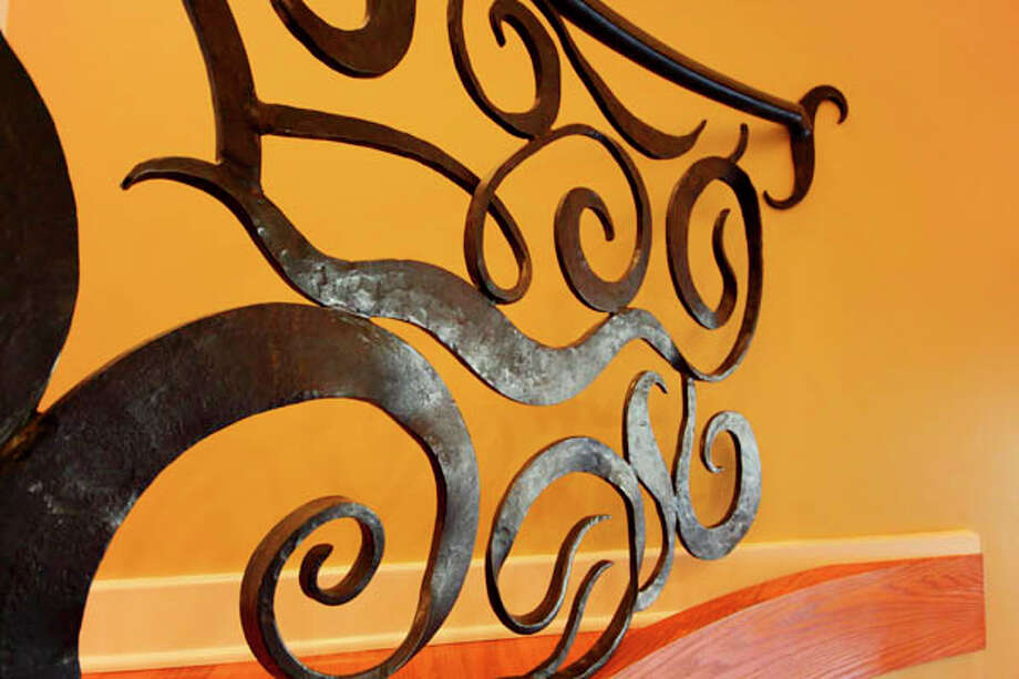 Detail of the curved metal staircase railings created by George Kaelber of Kaelber Custom Forging in Hyde Park. (Nancy Bruno/Life@Home) Click here to read the story.