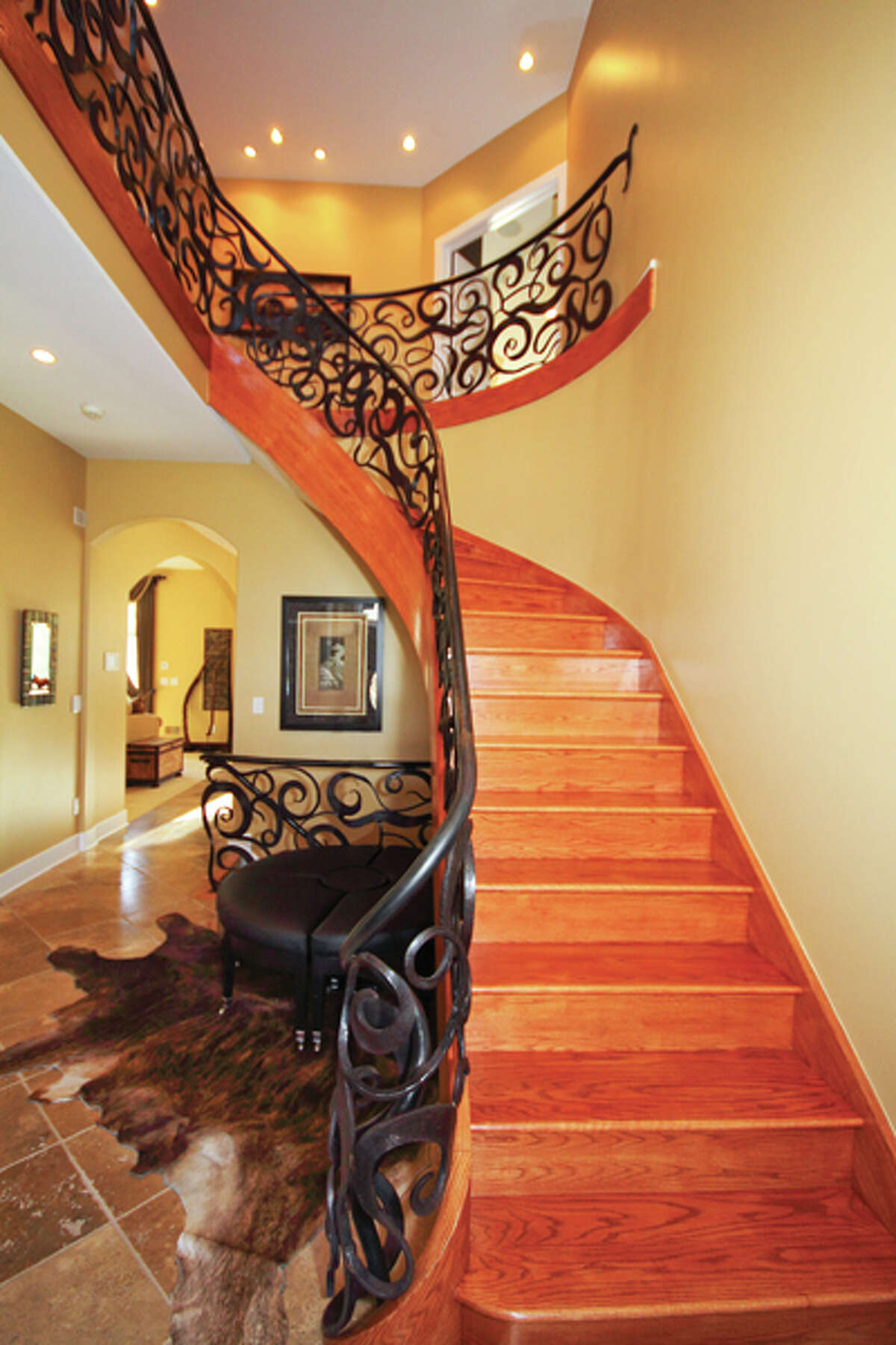 The curved metal staircase railings seen here were created by George Kaelber of Kaelber Custom Forging in Hyde Park. (Nancy Bruno/Life@Home) Click here to read the story.