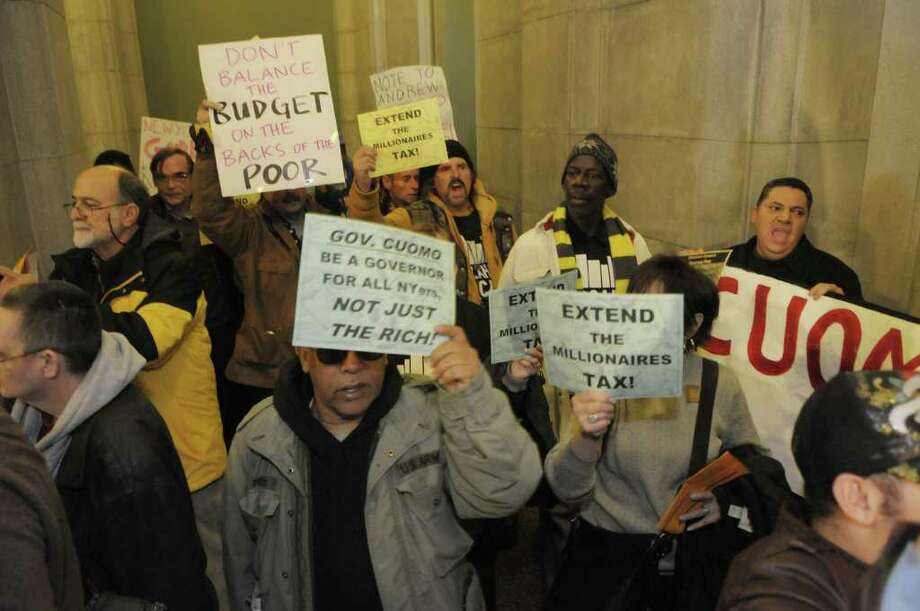 Protesters with the group Vocal New York march inside the Capitol as some also blocked entrances inside just off of State Street on Wednesday, March 2, 2011.  Several of the protesters were arrested.   (Paul Buckowski / Times Union) Photo: Paul Buckowski