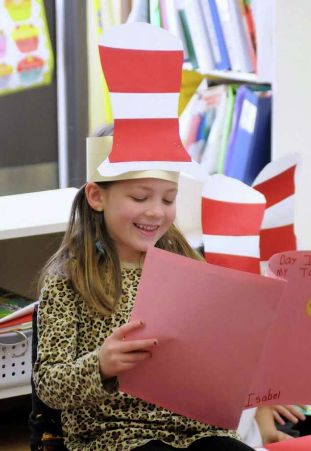 """First grade students at King Street Primary School in Danbury celebrated Dr. Suess' Birthday by participating in Read Across America on Wednesday Mar. 2, 2011. Student had the opportunity to read a book they wrote in school that was a """"Small Moments"""" assignment. Each student wrote a story about something special in their life while fellow studnets and parents listened. Pictured here is Isabel Allo, 6, from Linda Haywards class. Photo: Lisa Weir / The News-Times Freelance"""