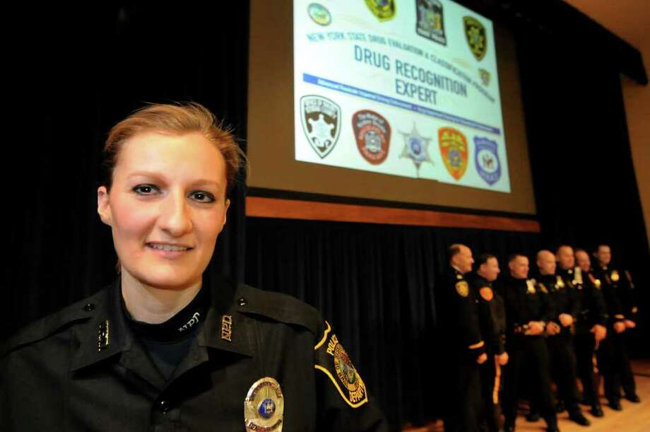 Bethany Vena of the Niskayuna Police Dept., left, graduates as a Drug Recognition Expert on Wednesday, March 2, 2011, at the New York State Police Academy in Albany, N.Y. (Cindy Schultz / Times Union) Photo: Cindy Schultz