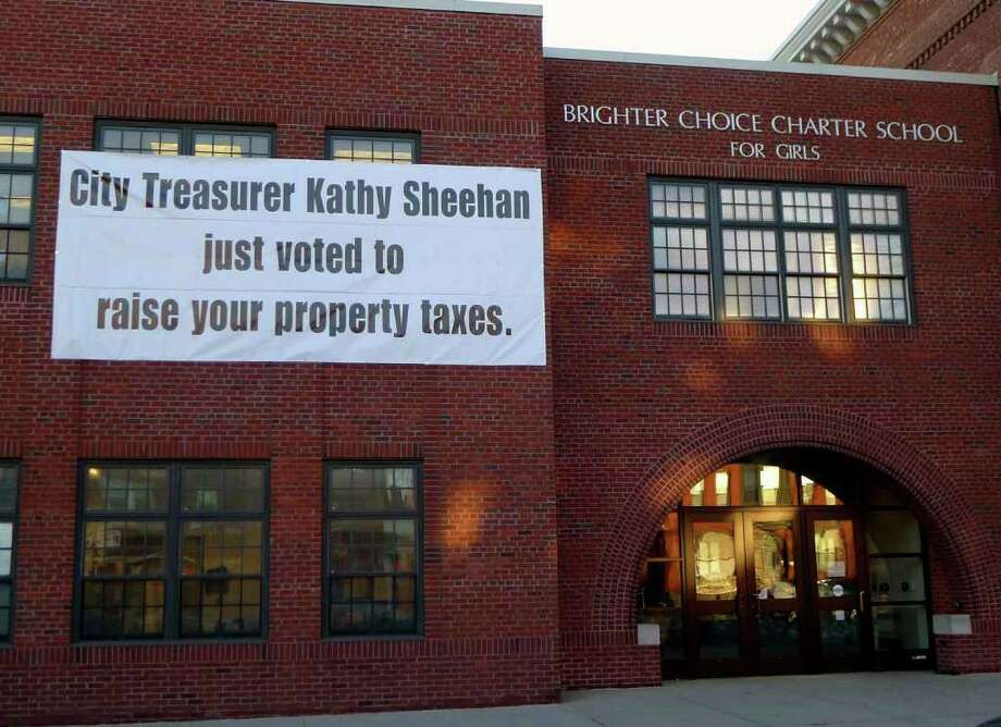"A sign outside Brighter Choices Charter School at 250 Central Ave reads "" City Treasuurer Kathy Sheehan just voted to raise your property taxes"" in Albany Wednesday March 2, 2011.( Michael P. Farrell/Times Union ) Photo: Michael P. Farrell / 00012265A"