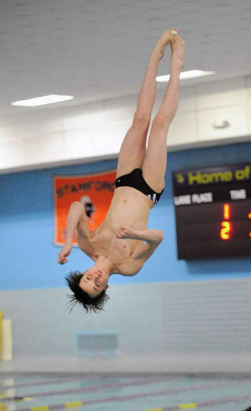 Sean Burston of the Westhill/Stamford High Schools combined swim team, competes in the FCIAC Diving finals at Westhill High School, Stamford, Wednesday night, March 2, 2011.