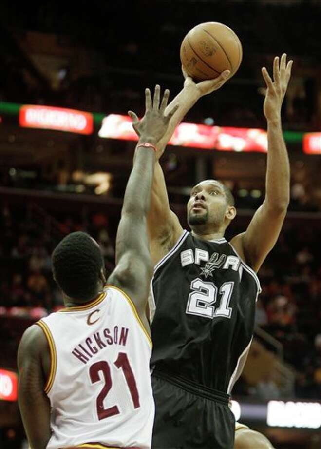 The Spurs' Tim Duncan (right) shoots over the Cavaliers' J.J. Hickson on Wednesday. (Tony Dejak/Associated Press) / AP 2010