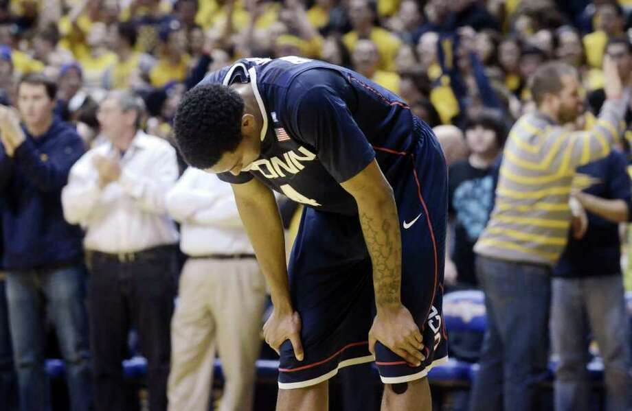 Connecticut's Jamal Coombs-McDaniel reacts during a 65-56 loss to West Virginia, Wednesday, March 2, 2011, during of an NCAA college basketball game in Morgantown, W.Va. (AP Photo/Jeff Gentner) Photo: AP
