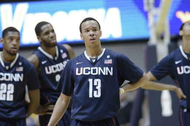 From left to right, Connecticut's Roscoe Smith, Alex Oriakhi, Shabazz Napier and Jamal Coombs-McDaniel react to a technical foul during a 65-56 loss to West Virginia, Wednesday, March 2, 2011, during the second half of an NCAA college basketball game in Morgantown, W.Va. (AP Photo/Jeff Gentner) Photo: AP