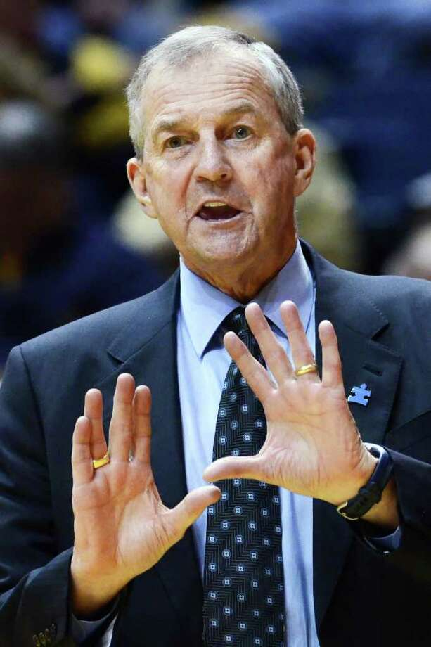 Connecticut's Jim Calhoun yells to his team against West Virginia, Wednesday, March 2, 2011, during the first half of an NCAA college basketball game in Morgantown, W.Va. (AP Photo/Jeff Gentner) Photo: AP