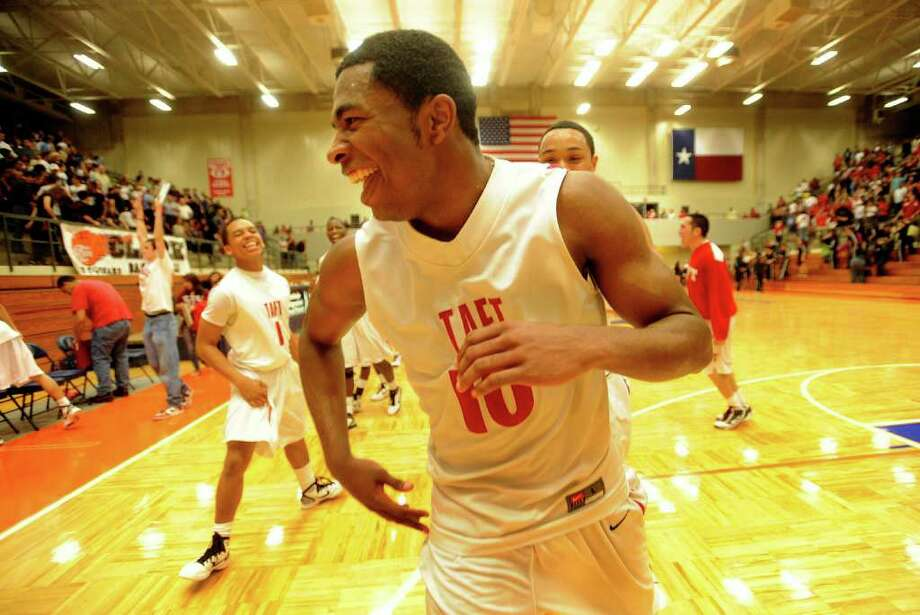 Taft senior guard Marshall Harris III celebrates after hitting the winning shot to defeat Clark in the UIL Region IV Regional Quarter Finals at the Taylor Field House on Wednesday, March 2, 2011. BILLY CALZADA / gcalzada@express-news.net  Taft Raiders vs. Clark Cougars Photo: BILLY CALZADA, SAN ANTONIO EXPRESS-NEWS / gcalzada@express-news.net