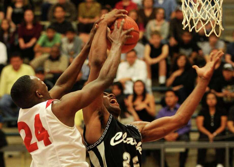 Taft's Deondre Logan (24) and Ansley Benjamin of Clark battle for a rebound during UIL Region IV Regional Quarter Finals at the Taylor Field House on Wednesday, March 2, 2011. BILLY CALZADA / gcalzada@express-news.net  Taft Raiders vs. Clark Cougars Photo: BILLY CALZADA, SAN ANTONIO EXPRESS-NEWS / gcalzada@express-news.net
