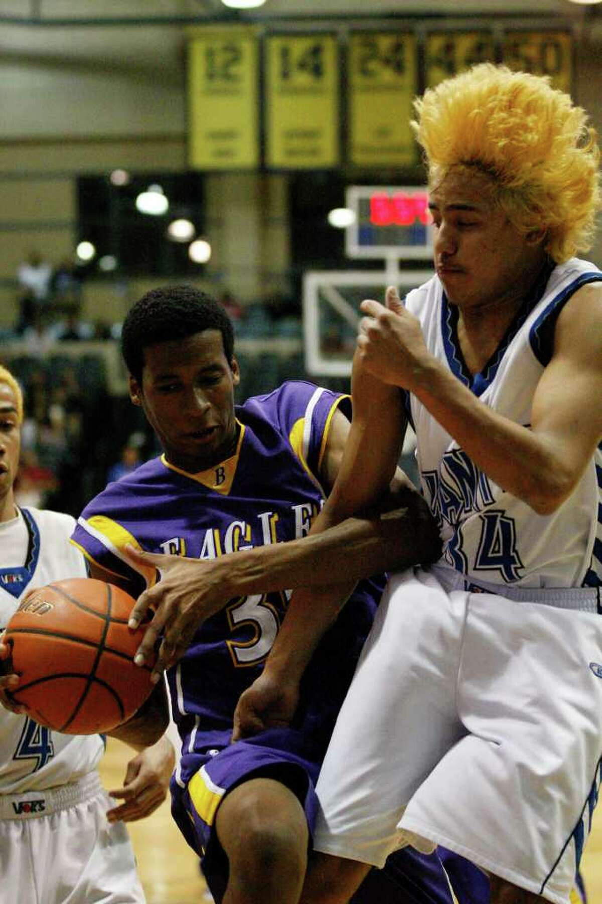 BKB -- Lanier Voks Ajax Reyes, right, battles it out with Brackenridge Eagles Emmanual Johnson in the Region IV Quarterfinals at Greehey Arena of St. Mary's University, Wednesday, March 2, 2011. Lanier went on to win, 51-47. JERRY LARA/glara@express-news.net