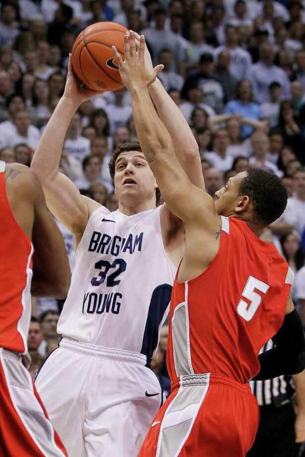 BYU guard Jimmer Fredette (32) is pressured by New Mexico guard Dairese Gary (5) during the first half of an NCAA college basketball game in Provo, Utah, Wednesday, March 2, 2011. (AP Photo/Colin E Braley) Photo: Colin E Braley
