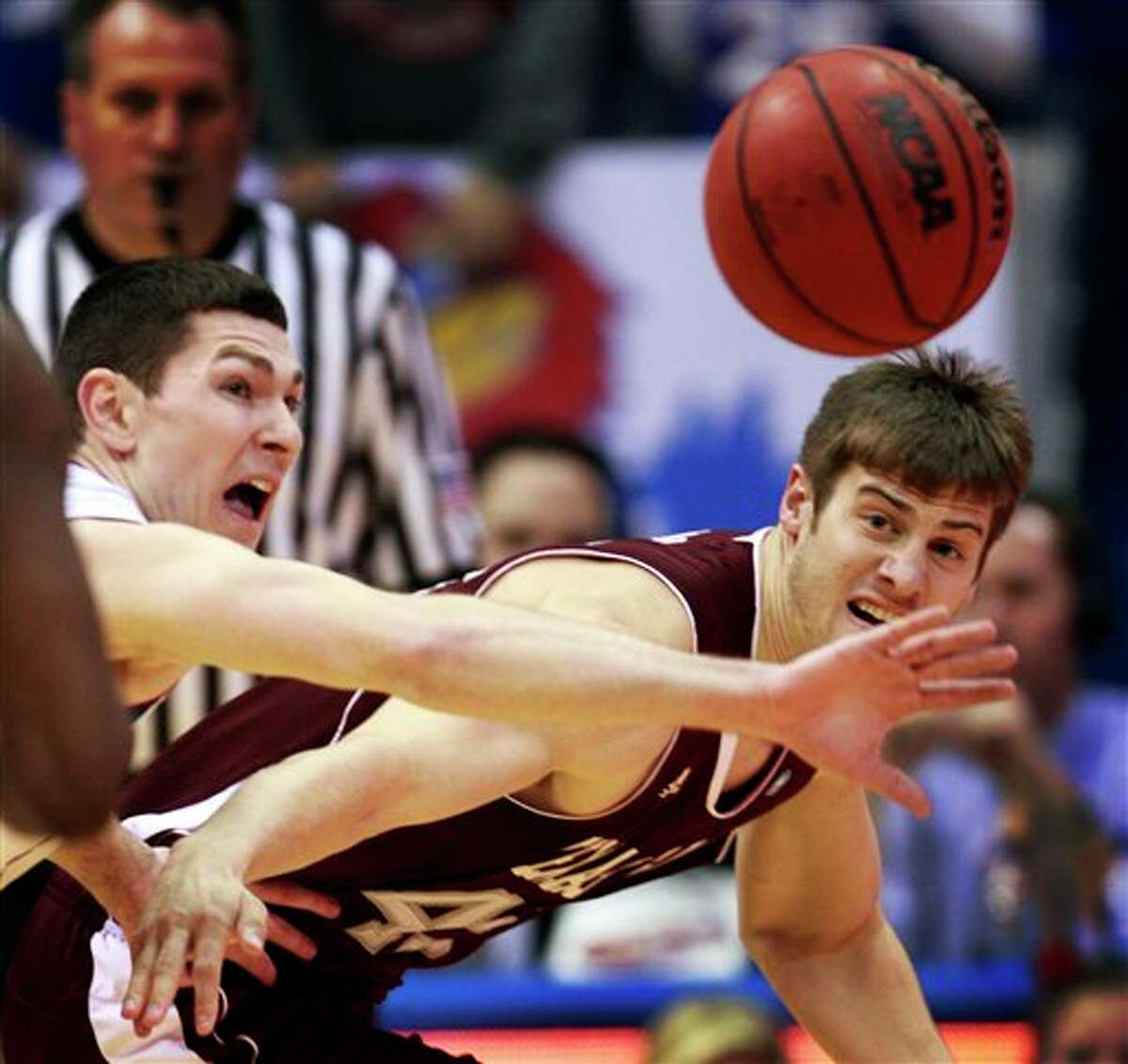 Kansas guard Tyrel Reed (left) attempts to keep the ball away from Texas A&M forward Nathan Walkup. ORLIN WAGNER/ASSOCIATED PRESS