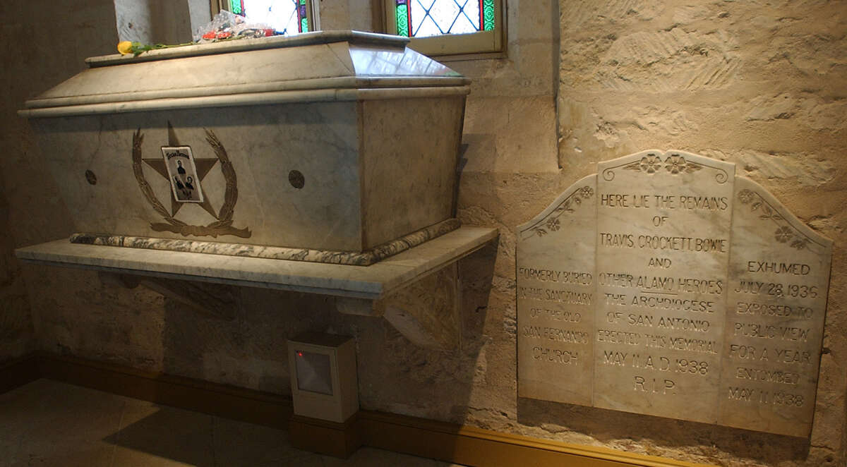 """Some Alamo historians contend Juan Seguín took the ashes from the Alamo's funeral pyres to San Fernando Cathedral. A plaque at the cathedral reads, """"Here lie the remains of Travis, Crockett, Bowie and other Alamo heroes."""""""