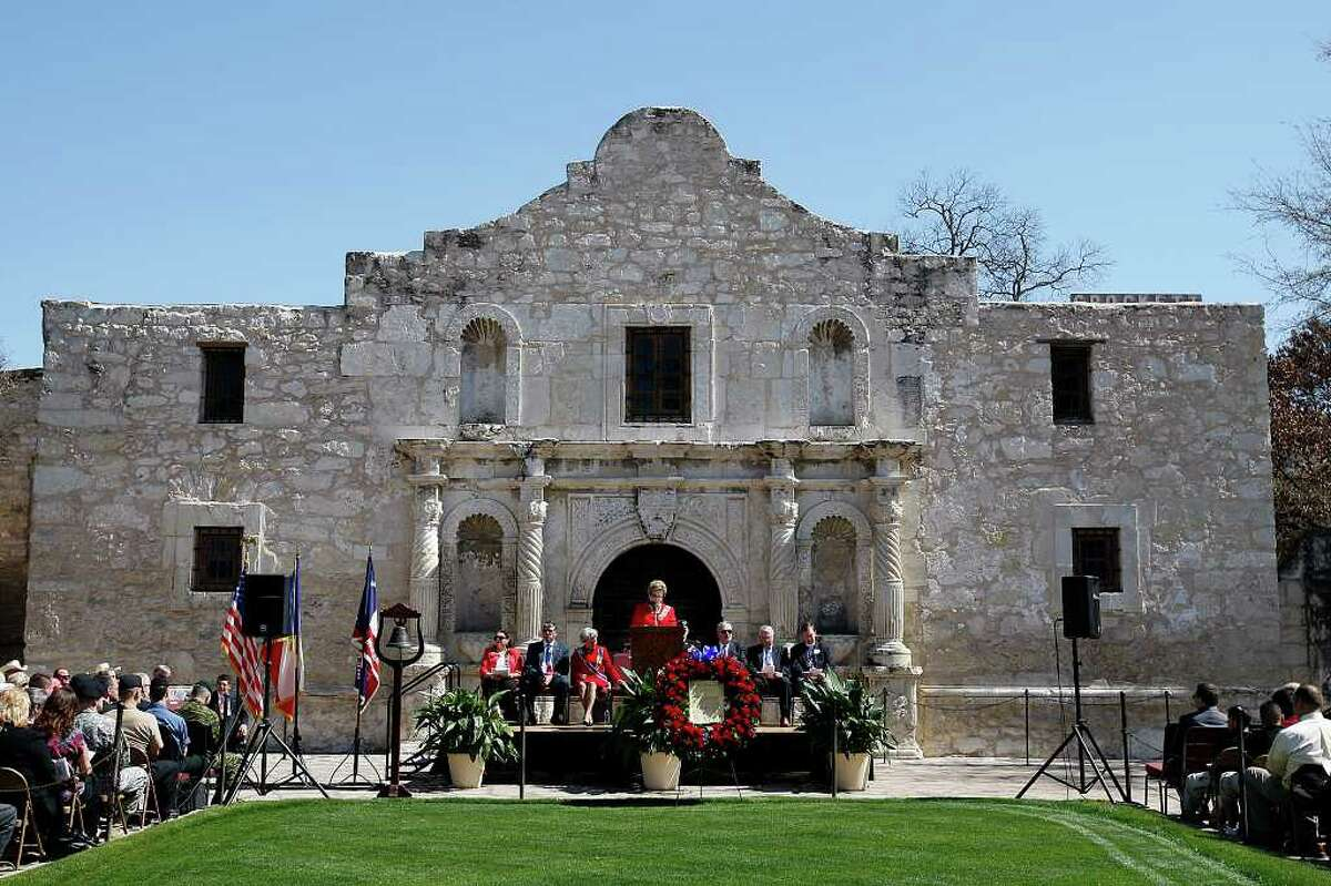 The Alamo Mission Chapter of the Daughters of the Republic of Texas honored educators and students of Texas history as part of the 175th anniversary of the state's independence during a celebration in front of the Alamo on Wednesday, March 2, 2011. The chapter's president, Jeanie Travis, is at the podium.