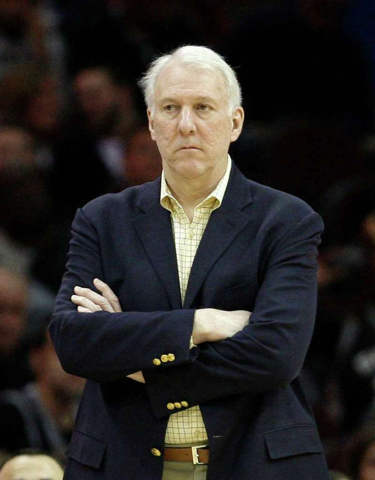 San Antonio Spurs head coach Gregg Popovich watches in the fourth quarter of an NBA basketball game against the Cleveland Cavaliers, Wednesday, March 2, 2011, in Cleveland.