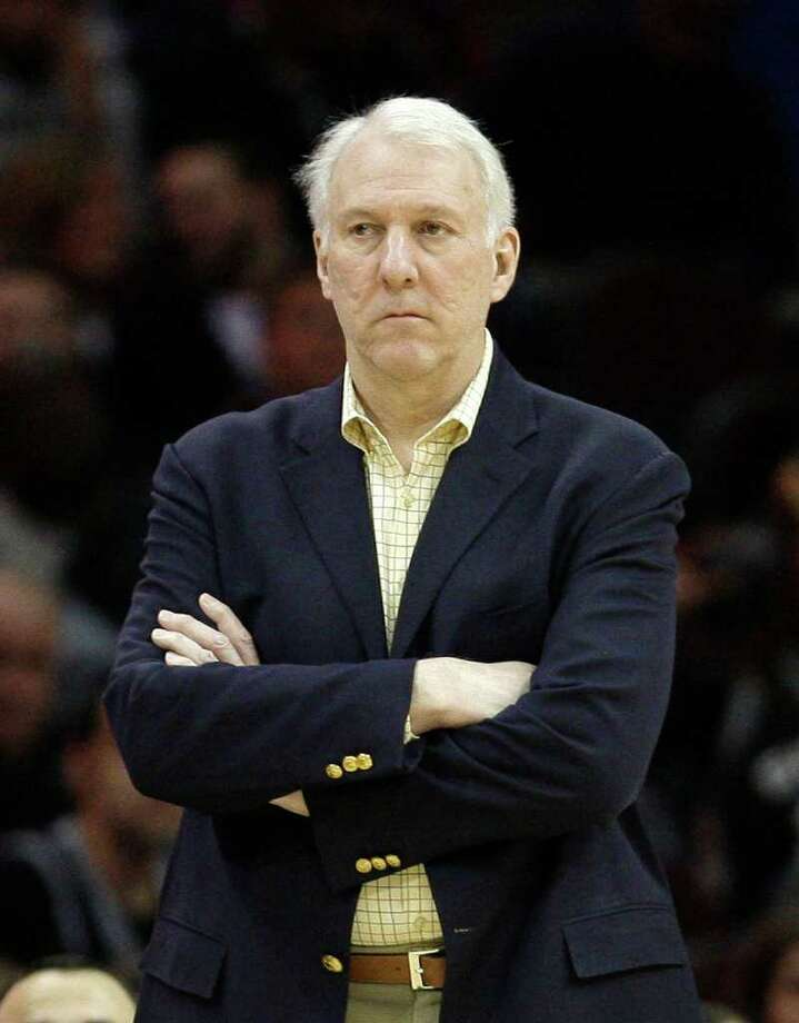 San Antonio Spurs head coach Gregg Popovich watches in the fourth quarter of an NBA basketball game against the Cleveland Cavaliers, Wednesday, March 2, 2011, in Cleveland. Photo: AP