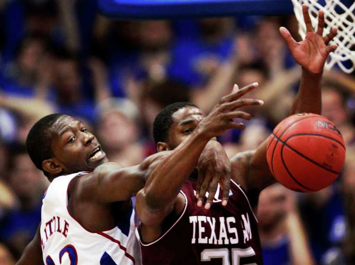 Kansas guard Mario Little (23) knocks the ball away from Texas A&M forward Ray Turner (35) during the second half of an NCAA college basketball game in Lawrence, Kan., Wednesday, March 2, 2011. Kansas defeated Texas A&M 64-51.