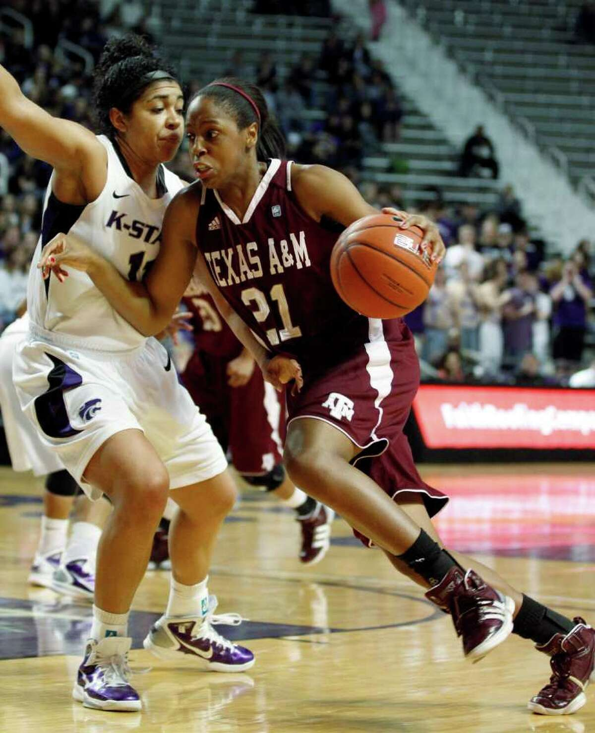 Kansas State's Chantay Caron (11) guards Texas A&M forward Adaora Elonu (21) during the first half of an NCAA college basketball game, Wednesday, March 2, 2011, in Manhattan, Kan.