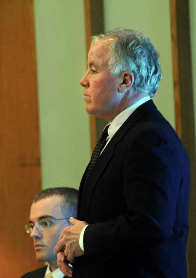 Christopher DiMeo looks ahead as defense attorney Michael Courtney questions a witness in Superior Court in Bridgeport, Conn. March 1, 2011, during the penalty phase of his trial.  DiMeo was found guilty of two counts of murder and one count each of first-degree robbery and capital felony in the deaths of Tim and Kim Donnelly during the robbery of their Fairfield jewelry store in February of 2005. Photo: Autumn Driscoll / Connecticut Post