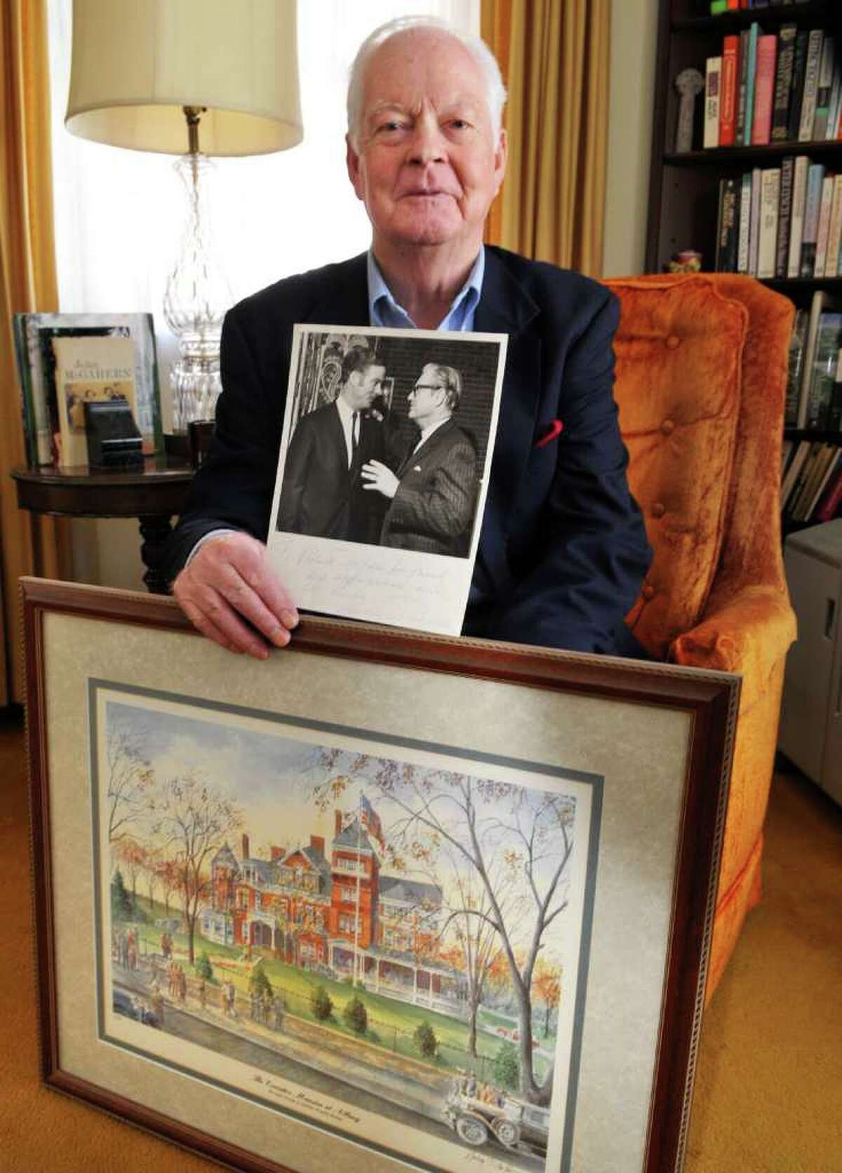 Robert Bennett with mementos of his tenure as superintendent of the NYS Executive Mansion, an autographed photo of Bennett with Gov. Nelson Rockefeller and an early 19th century view of the mansion at his Albany home Wednesday afternoon Mar. 2, 2011. (John Carl D'Annibale / Times Union)
