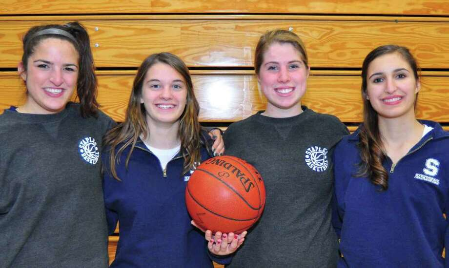 From left, Staples senior captains MK Van Sant, Julie Strickland, Nikki Brill and Julia Friedman capped their careers Tuesday in a 56-42 loss to Hall in the Class LL playoffs. Photo: Contributed Photo / Tom Werner