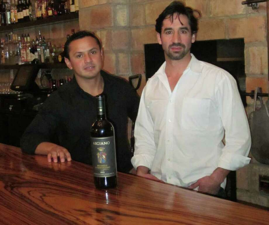 Vincente and Marco Siguenza, co-owners of Scena Wine Bar and Restaurant, stand behind the bar. Photo: Contributed Photo / New Canaan News