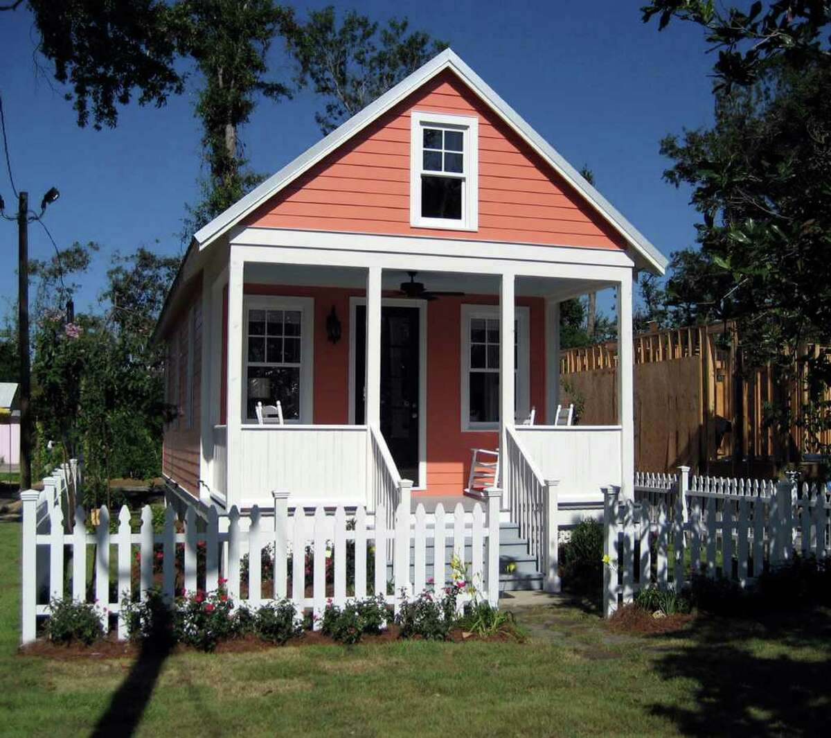 Thi 2006 photo courtesy of Lowe's shows a Katrina Cottage designed by Marianne Cusato in Ocean Springs, Miss. This design packs a living room, two bedrooms and one bath into 544 square feet. The tiny charmers with pitched roofs, nostalgic front porches and 300 to 1,800 square feet, are becoming popular in other parts of the country too; Lowe's home stores sell the blueprints and materials. (AP Photo/Lowe's) NO SALES
