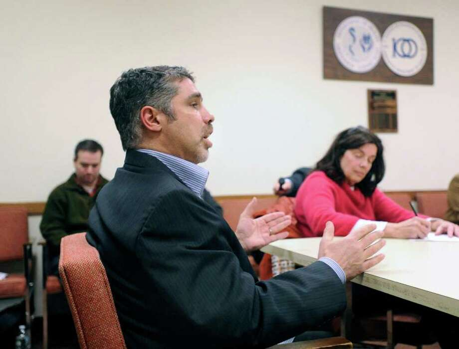 "Old Greenwich resident Gary Dell'Abate, who is better known by the moniker Baba Booey as the producer of ""The Howard Stern Show,"" speaking to the Representative Town Meeting's Appointments Committee at Greenwich Town Hall, Feb. 8, 2011. At right, taking notes, is Coline Jenkins of Old Greenwich, an Appointments Committee member. The committee endorsed Dell'Abate for a seat on the town's Board of Parks and Recreation, with Jenkins abstaining. Photo by Bob Luckey 2/10/11 GT photo = Baba Booey's Defender. Shock jock Stern rips RTM. by Neil Vigdor 2/15/11 GT photo = Criticized Howard Stern. RTM member finds feces in mailbox. by Neil Vigdor Photo: Bob Luckey, Greenwich Time / Greenwich Time"