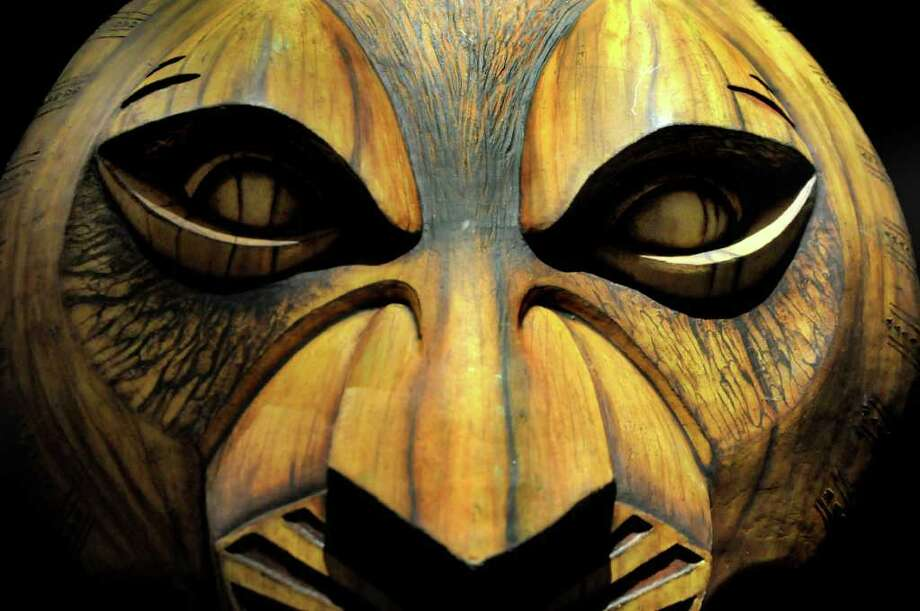 To suggest the continuing presence of the late ruler Mufasa in ?The Lion King,? a large mask of his face looms over the action in several scenes. The musical will be performed at Proctors in Schenectady through March 28. (Cindy Schultz / Times Union) Photo: Cindy Schultz