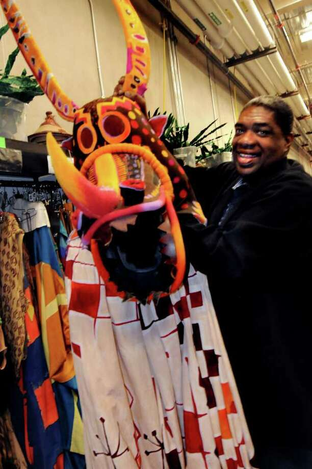 Wardrobe supervisor Gregory Young directs a staff that, during a show?s run, spends three days a week on costume maintenance and repair. He?s holding the headpiece and jumpsuit for a character called a Trickster; union rules preclude him from wearing them. (Cindy Schultz / Times Union) Photo: Cindy Schultz